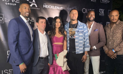 Erik Miles (left) of VH1's Love & Listings takes a photo with some of his clients at the Love & Listings launch party. (Photo Credit: Shannen Hill)