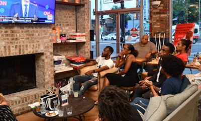 Young people gathered at Halfsmoke in Northwest on Tuesday, July 30 to watch the first night of the second round of Democratic debates with members of #BlackYouthVote. (Anthony Tilghman/The Washington Informer)