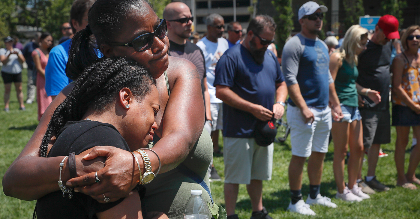 Mourners gather at a vigil following a nearby mass shooting Aug. 4, in Dayton, Ohio. Multiple people in Ohio have been killed in the second mass shooting in the U.S. in less than 24 hours, and the suspected shooter is also deceased, police said. Photo: AP/Wide World Photos