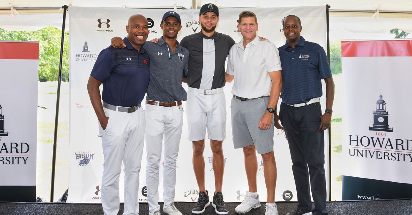 "Howard University student Otis Ferguson (second from left) inspires Stephen Curry (center) to fund a new golf team for Howard University. Also pictured are Howard University Athletic Director Kery Davis (far left) Calloway CEO Oliver ""Chip"" Brewer (second from right) and Howard University President Wayne Frederick (far right). (Photo: Howard University)"