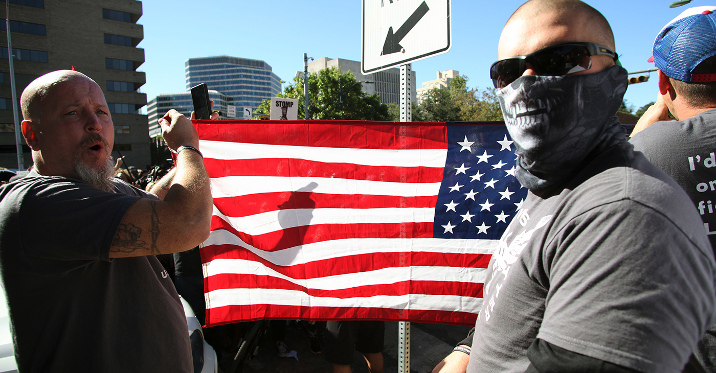 Austin, Texas, USA - November 19, 2016: 'White Lives Matter' demonstrators display an American flag at a protest just south of the Capitol grounds. The 'White Lives Matter' demonstrators, numbering about 20 people at the most, came from Houston with the message that the hate crime law is unfair to white people. (Photo: iStockphoto / NNPA)