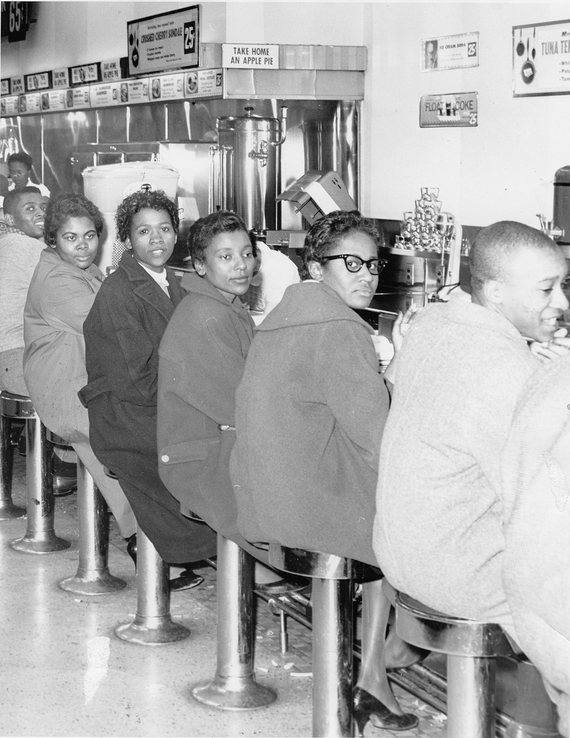Students from Norfolk's Booker T. Washington High School stage set in at Granby Street's Woolworth's lunch counter. Photo: New Journal and Guide Archives
