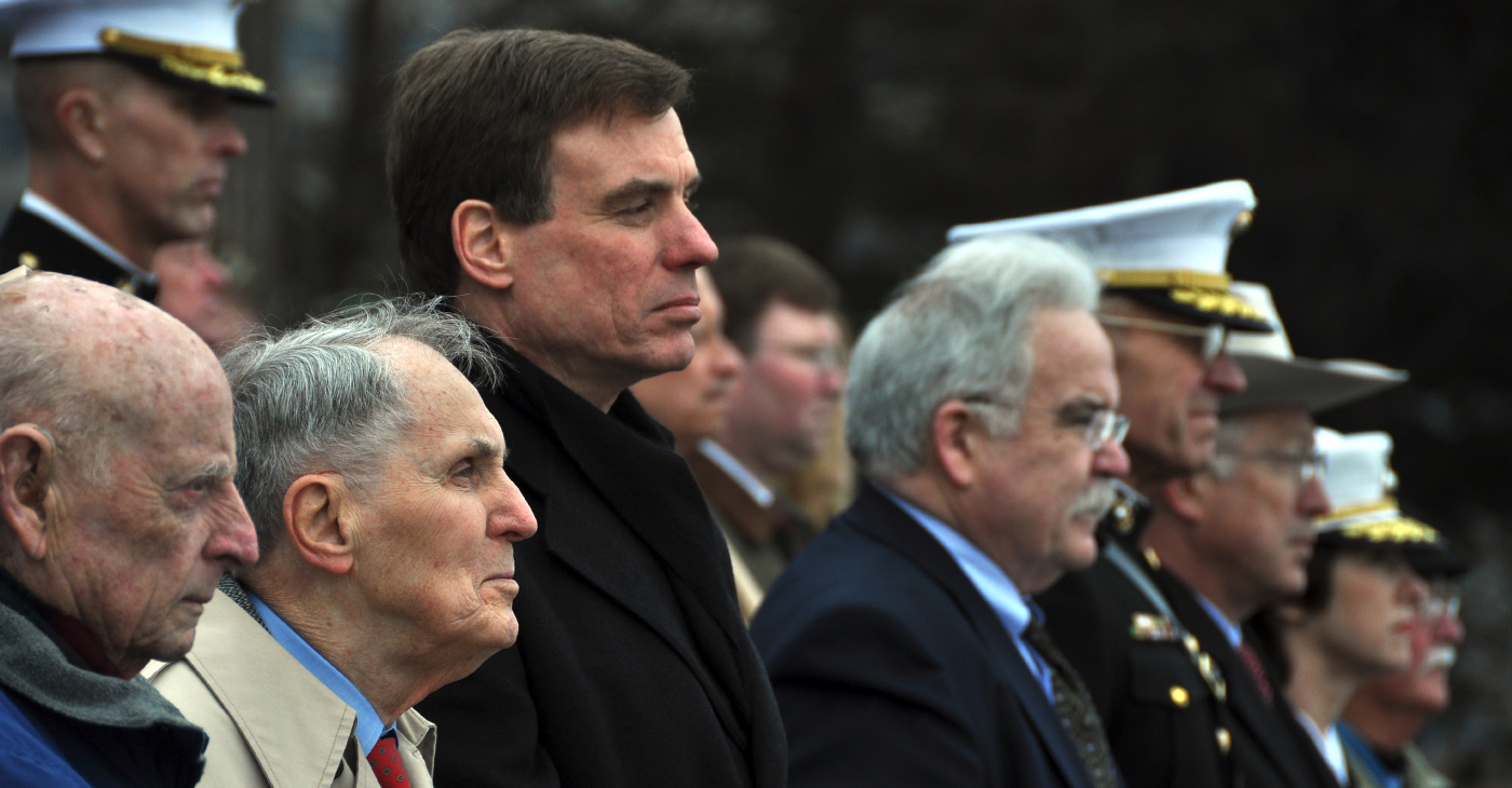 Sen. Mark Warner of Va. (3rd from L) joined World War II veterans at the U.S. Marine Corps Memorial in Arlington, Va., on Tues., Feb. 23, 2010, to commemorate the 65th anniversary of the raising of the U.S. flag at Iwo Jima. The Senator's father, Robert Warner of Vernon, CT, (2nd from L) and James L. Wheeler of Falls Church, VA (far L) are both retired Marines who fought at Iwo Jima. (Photo by Riki Parikh/Sen. Warner's Office)
