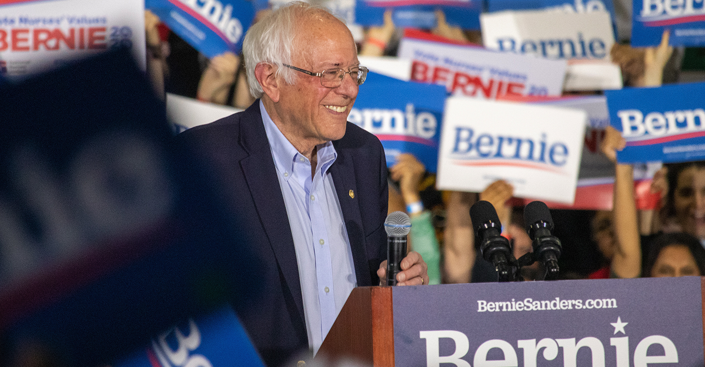 U.S. Senator en:Bernie Sanders smiling at a campaign rally on 1 March 2020. (Photo: Wikimedia Commons)
