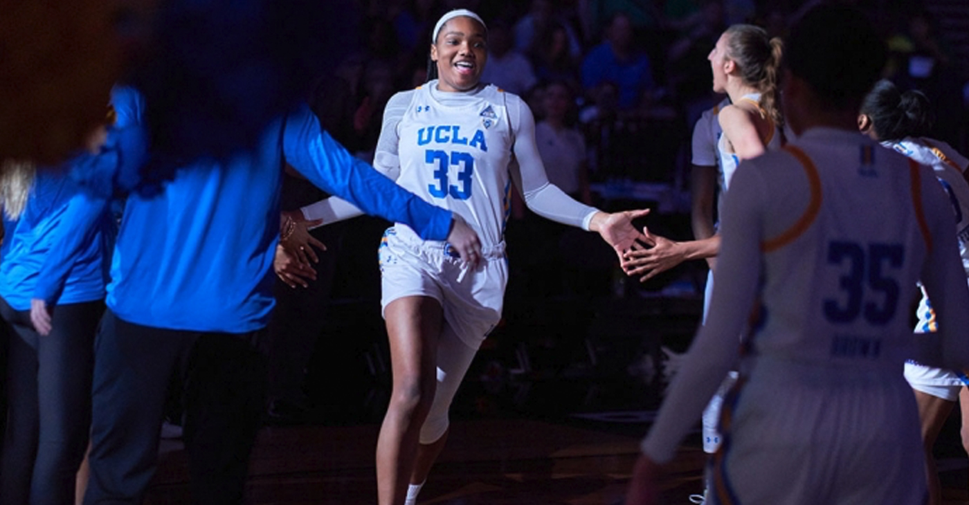UCLA forward Lauryn Miller (33) runs onto the court after being announced at the Pac-12 Women's Semifinals (Omer Khan/tgsportstv1)