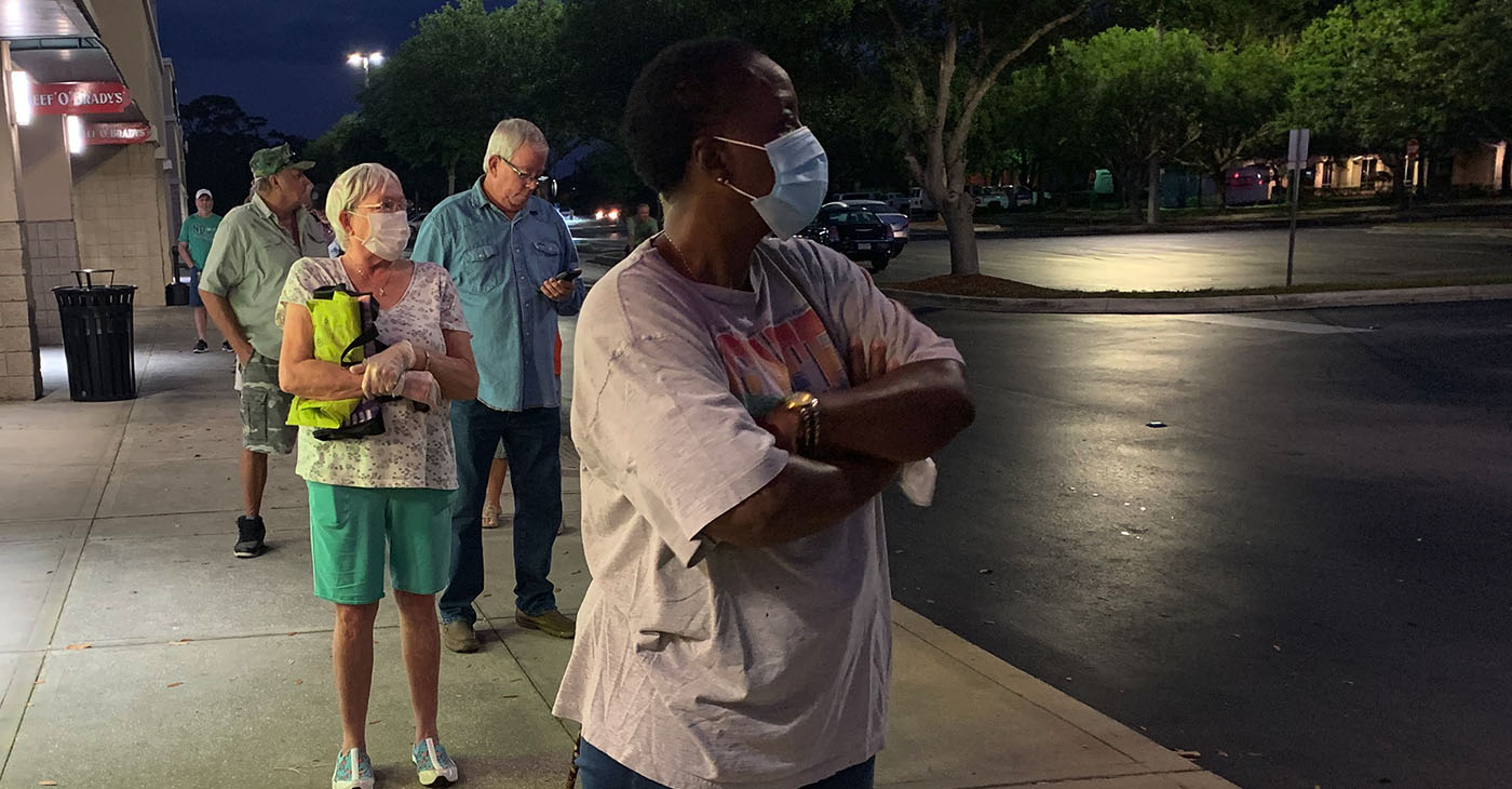 Senior citizens use social distancing while lined up for the early opening of a supermarket on for seniors only. The US government has called for social distancing to slow the spread of the Covid 19 virus. This is at a Publix supermarket in Cocoa, Florida, which opened at 7:00 am for seniors 65 and over. Some are wearing surgical masks. (Photo: iStockphoto / NNPA)