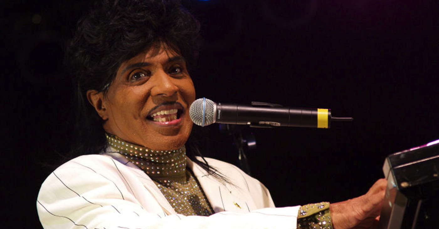 Little Richard's high-energy performances while playing the piano included dancing on top of the piano, running on and off the stage and throwing souvenirs to the audience. He also dressed flamboyantly onstage. Some of what is taken for granted now in popular music was invented by Little Richard. (Photo: Little Richard performing at the University of Texas Forty Acres Festival in 2007. Wikimedia Commons / Anna Bleker)