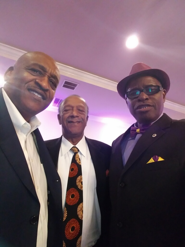 Gantt with Omega Psi Phi Fraternity brothers Dr. Glenn Cherry, CEO of the Florida Courier and Daytona Times newspapers, and Louis Muhammad of the Nation of Islam.