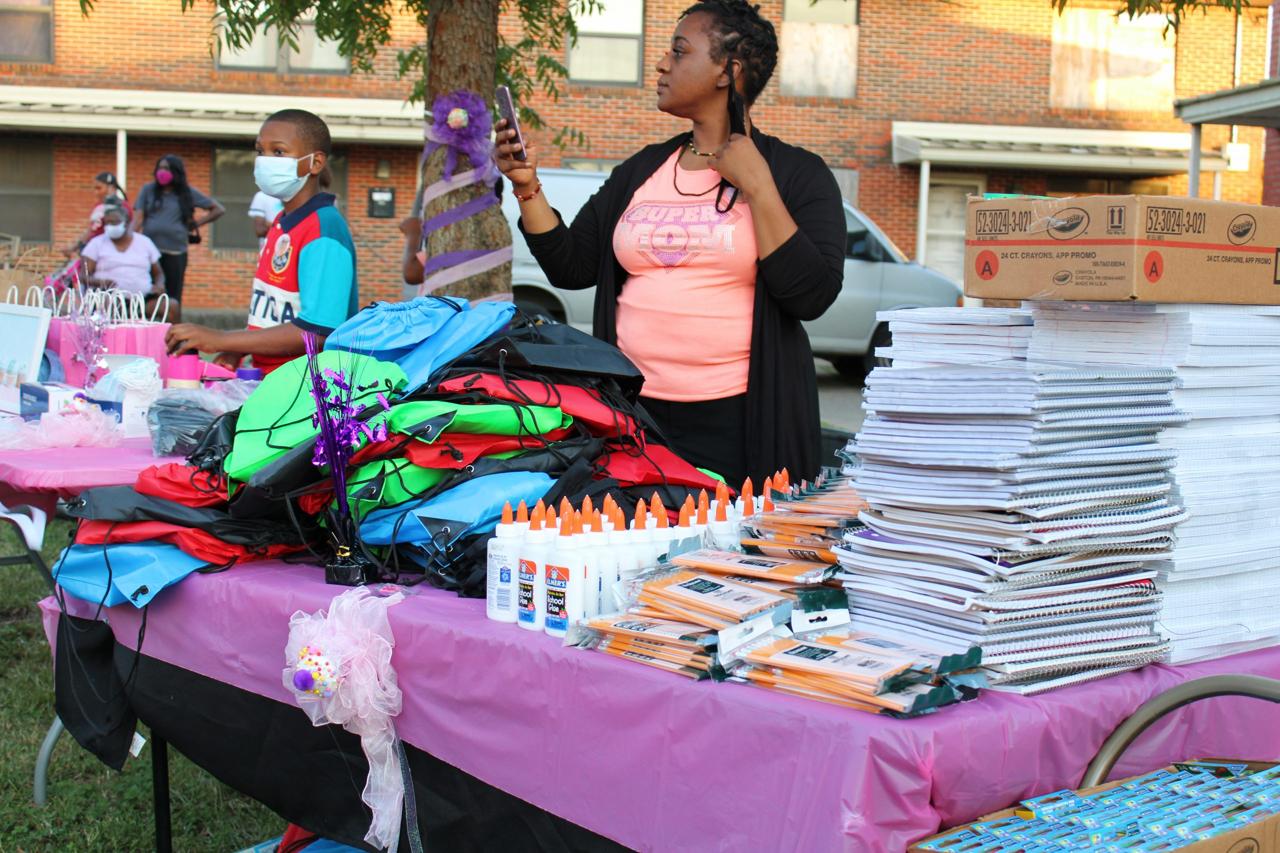 """During the first annual memorial tribute to Kamille """"Cupcake"""" McKinney, community organizers held a school supply giveaway for the Avondale community. (Sydney Melson, For The Birmingham Times)"""