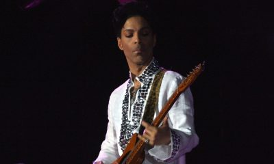 "On the title track, Prince sings: ""Welcome 2 America, the land of the free – home of the slave."" Prince fans know that track is reminiscent of his 1985 song, ""America,"" from his ""Around the World in a Day"" album. (Photo: Prince playing at Cochella, 2008. / Wikimedia Commons)"