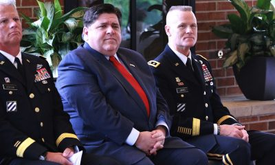 Illinois Governor JB Pritzker, First Army Commander Lt. Gen. Thomas S. James and Illinois National Guard Deputy Assistant Adjutant General - Army Brig. Gen. Mark Jackson listen to Illinois Department of Veteran Affairs Acting Director Linda Chapa LaVia speak during the Gold Star Mothers Luncheon The Illinois Department of Veteran Affairs Gold Star Mothers Luncheon gives senior civilian and military leaders a chance to thank Gold Star mothers for their service to our nation and its military. Governor JB Pritzker thanked the Gold Star Mothers and said he was humbled to have the opportunity to speak with them. In addition to the sacrifice their sons and daughters gave to their nation, many Gold Star mothers keep their Fallen Heroes memories alive and continue their service to the community and to the military, said Lt. Gen. Thomas S. James, the Commander of First Army and keynote speaker at the luncheon. The luncheon was held at the First Infantry Division Museum at Cantigny in Wheaton, Illinois, on Sunday, Sept. 29. (Photo: Lt. Col. Bradford Leighton / Wikimedia Commons)