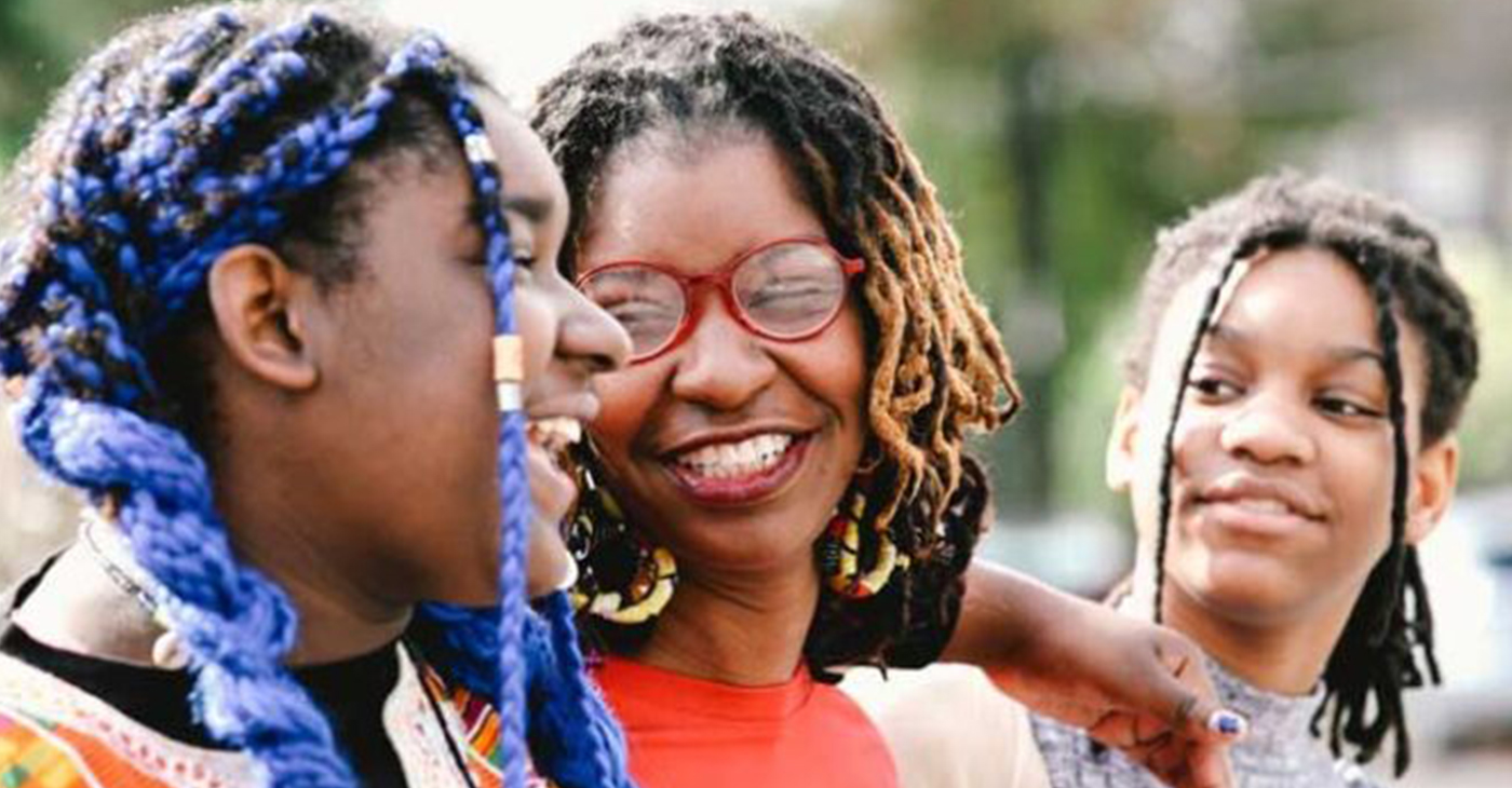 Nia Weeks, Founder and Executive Director of Citizen SHE United in New Orleans, with her two daughters, Peyton (left) and Cameron (right) [Photo credit: Phoebe Jones/WWNO]