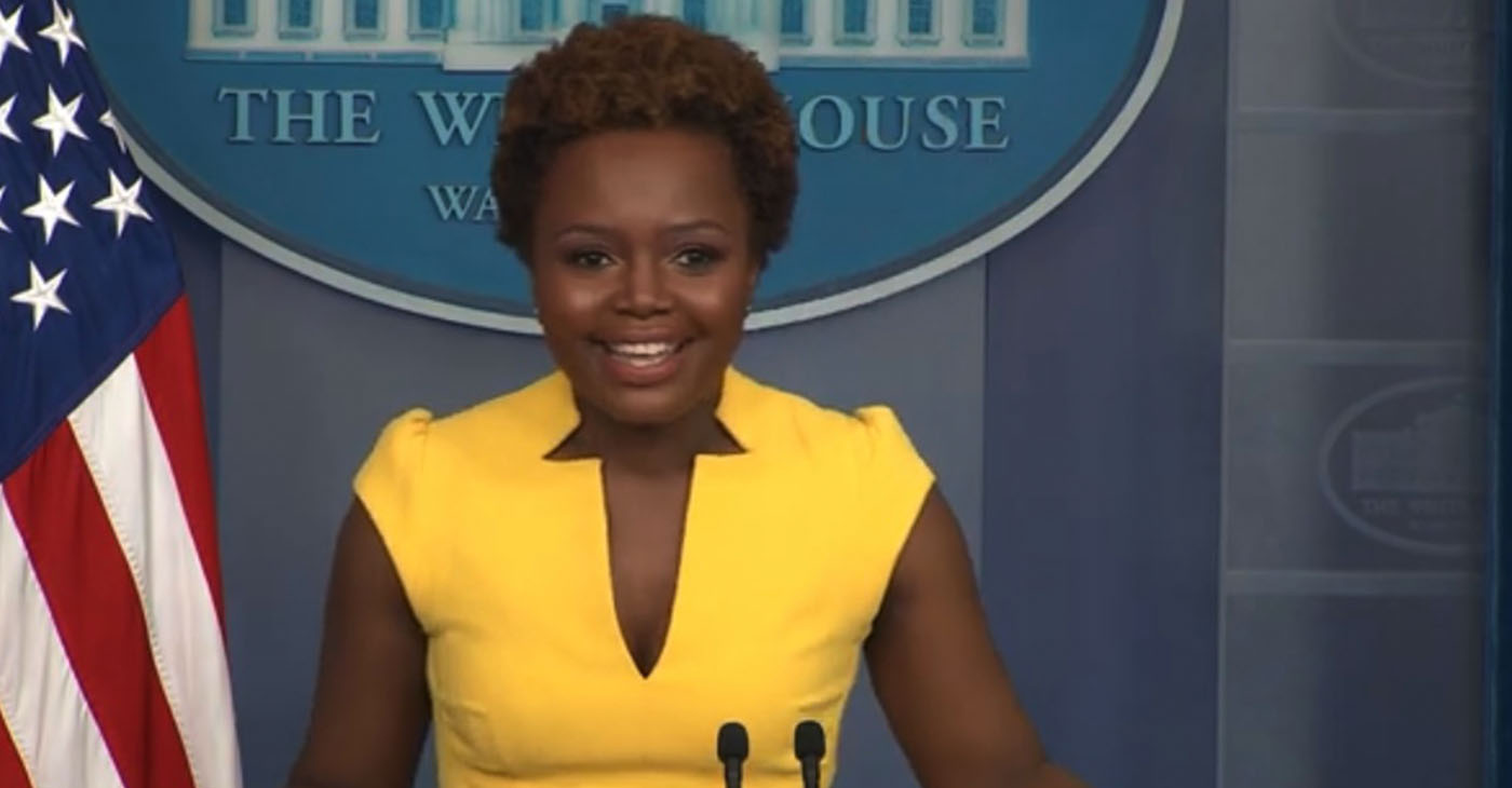 Principal Deputy Press Secretary Karine Jean-Pierre conducts press briefing at the Biden White House, becoming first openly gay spokeswoman and second Black woman ever to hold the role. Screencap at 0:11.
