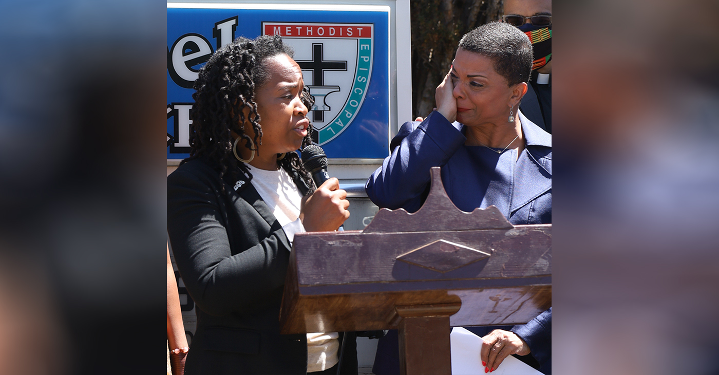 Rev. Dr. Rosalynn Brookins, Parks Chapel AME Church Oakland, wipes away tears as Council Member Carroll Fife, 3rd District, promises to help the church and the community combat the issues arising from the increase in homelessness in the Bay Area, at a press conference addressing the presence of a homeless encampment located behind Parks Chapel African Methodist Episcopal Church in Oakland on May 19, 2021. Photo by Christy Price