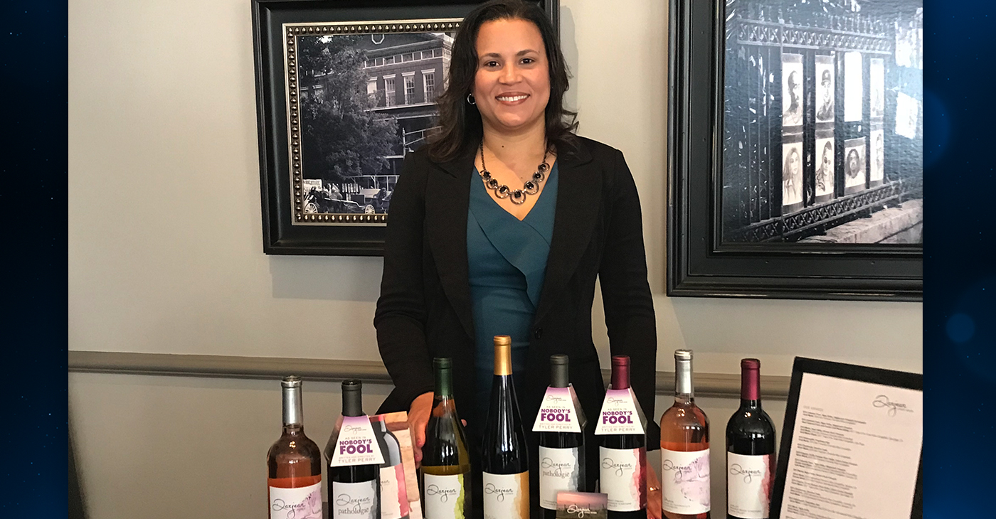 """Dawna Jones, vintner and plant scientist, poses with her Darjean Jones Wines which were featured in Tyler Perry's """"Nobody's Fool"""""""
